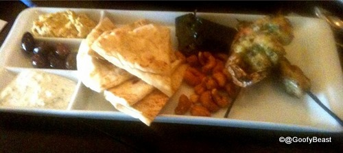 Kouzzina Sampler: Prawns and Chicken on Skewers, Olives, Spiced Cashews, Dolmades, Tzatziki, Hummus and Pita