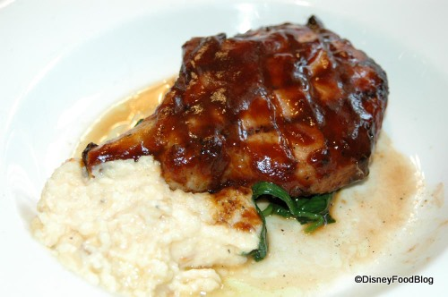 Grilled Pork Chop with Chipotle Barbecue Sauce and Smoked Cheddar Grits