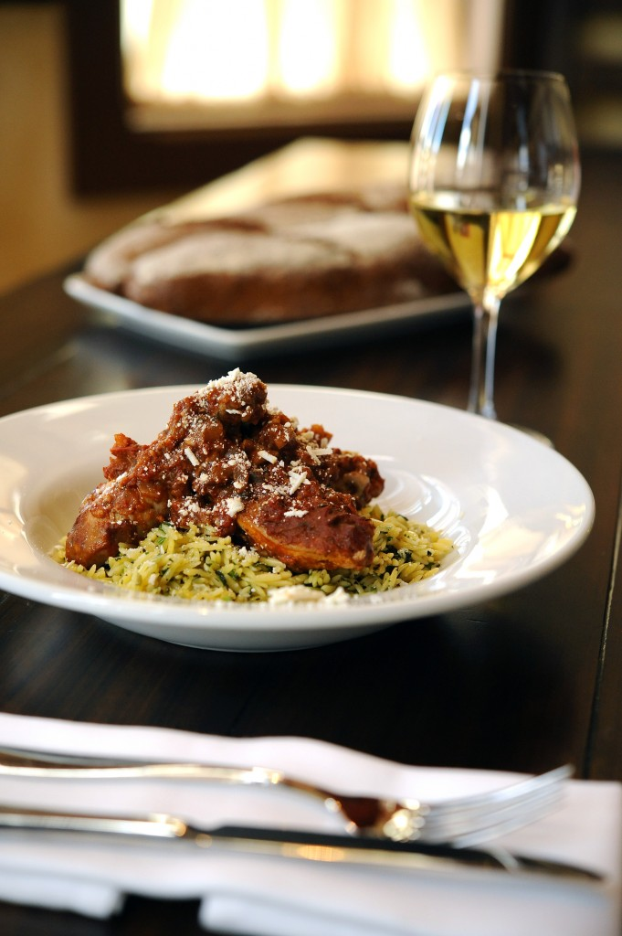 Kouzzina Cinnamon-stewed chicken, with tomatoes, herbed orzo and Mizithra cheese
