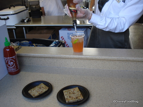 The Plum Wine pour and some rice pancakes in the China booth