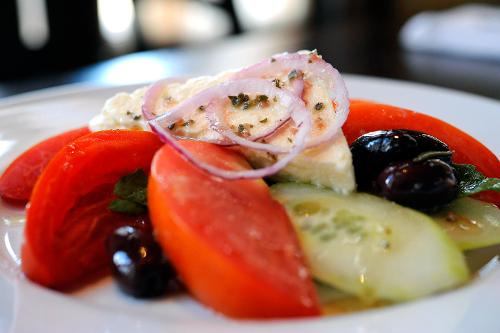Kouzzina Spiro's Salad: tomatoes, cucumbers, red onions, kalamata olives and feta