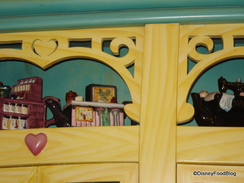 Minnie's Stores Collected Teapots Above the Cabinets