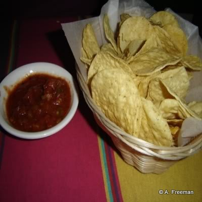 Tortilla Chips and Salsa are served to every table