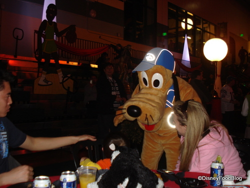 Pluto Greets Guests