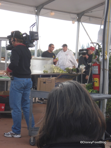Chef Irvine Instructs a Sous Chef in the Show Kitchen