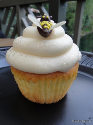 Honey Lemon Cupcake Topped with Edible Glitter & A Chocolate Bee