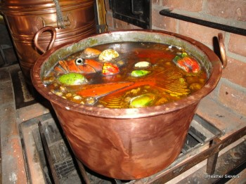 Fish Stew Cooking Up for the Crew in the Galley