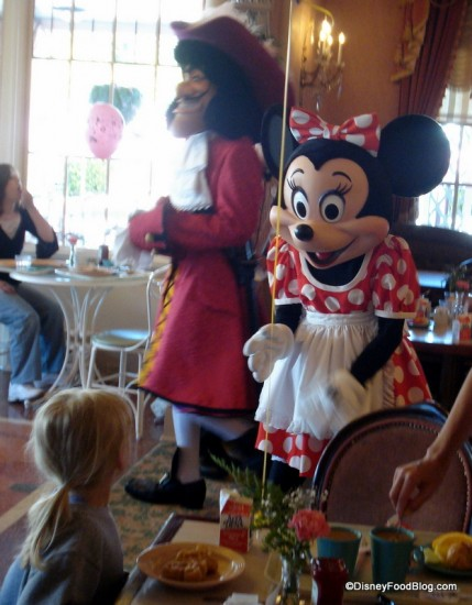 Minnie greets her guests