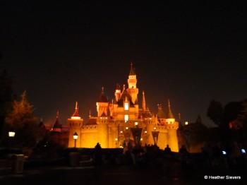 Sleeping Beauty's Castle Glows Orange at Mickey's Halloween Party