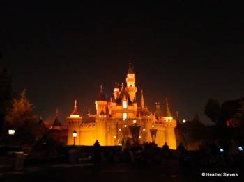 Sleeping Beauty's Castle Glows Orange at Mickey's Halloween Party