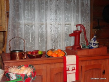 Santa's Kitchen Counter with Apples, Oranges, and a Basket of Eggs