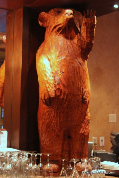 Carved Wooden Bear Holding up the Bar