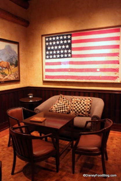 Americana Decor and a Cozy Loveseat Make for an Inviting Space