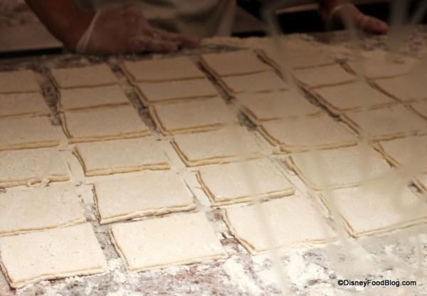 cut beignets ready for frying Ralph Brennan's Jazz Kitchen Express