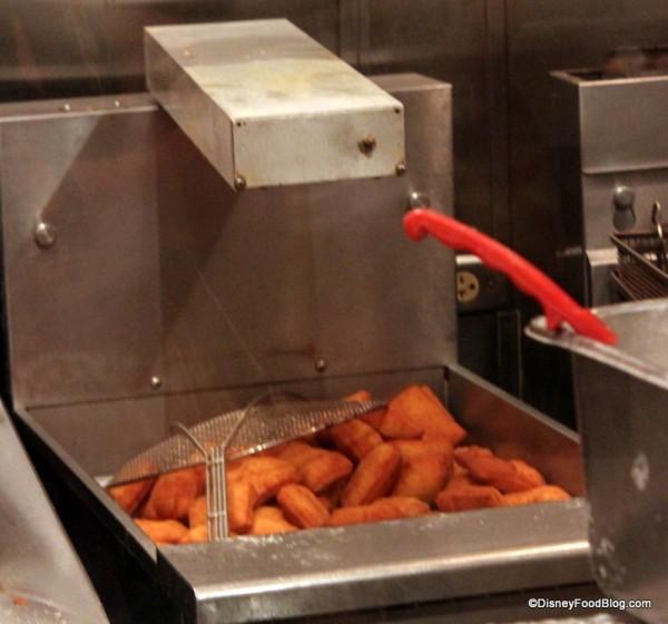 frying beignets Ralph Brennan's Jazz Kitchen Express
