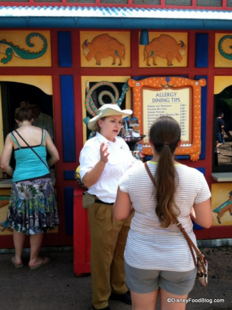 A Cast Member Provides a Guest with Information at the Gardens Kiosk in Disney's Animal Kingdom