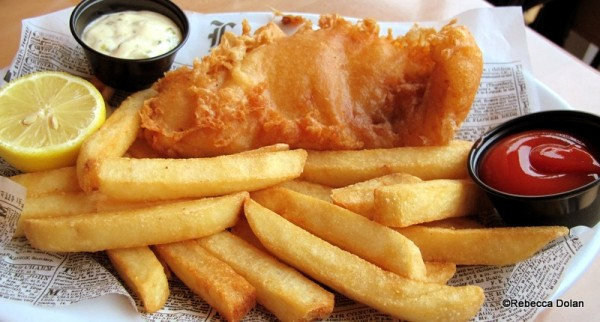 Classic beer-battered fish and chips with tartar sauce.