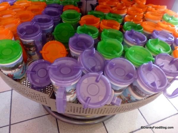 Green, purple, and orange mugs