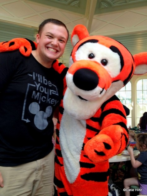 My husband shares a man hug with Tigger