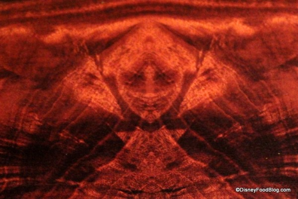 Evil Queen in the Wood Grain of a Table. How Do They Do This Stuff?