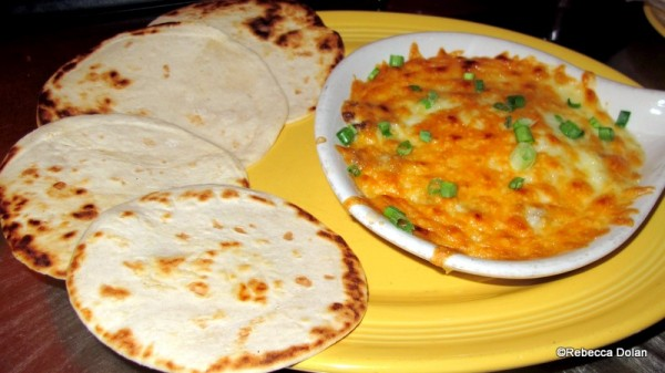Queso fundito and accompanying tortillas for scooping