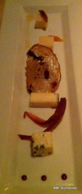 An assortment of cheeses after the main entrée course