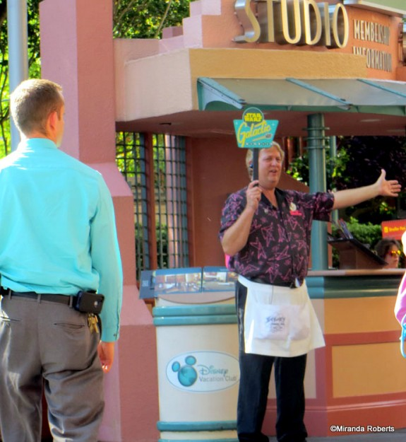 Cast Member directs guests to the galactic breakfast!