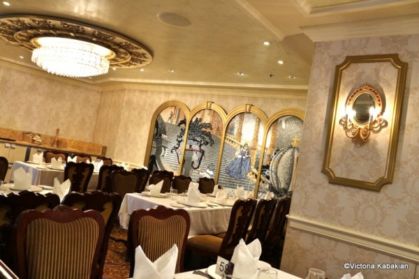 The dining room space near the Cinderella mosaic—gorgeous lighting too!