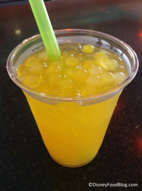 Mango green tea with popping bubbles