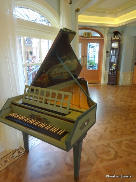 Lillian Disney's harpsichord a top the beautiful inlaid wood floors.