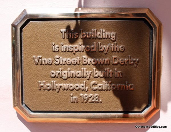 Plaque noting the inspiration for the building