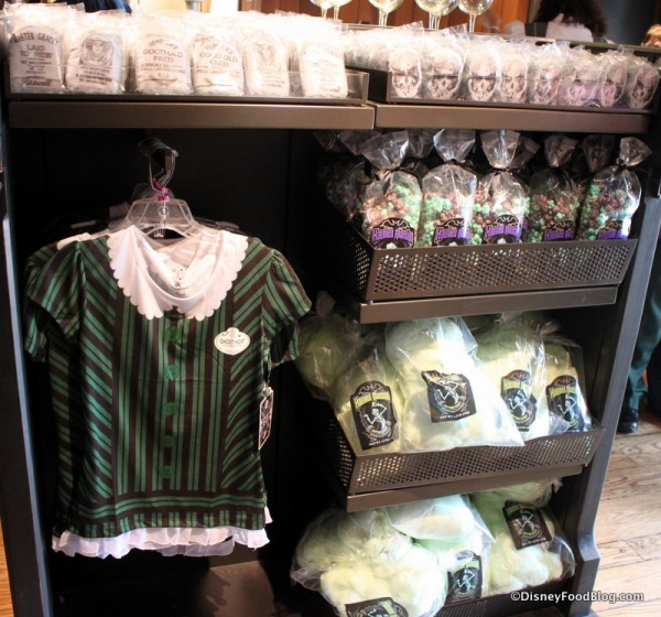 Women's Haunted Mansion Cast Member shirt in display