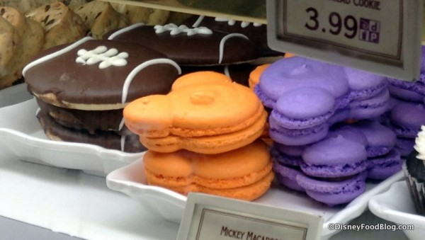 Football sugar cookie and autumn colored Mickey Macarons