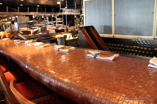 Bar seating in front of the kitchen