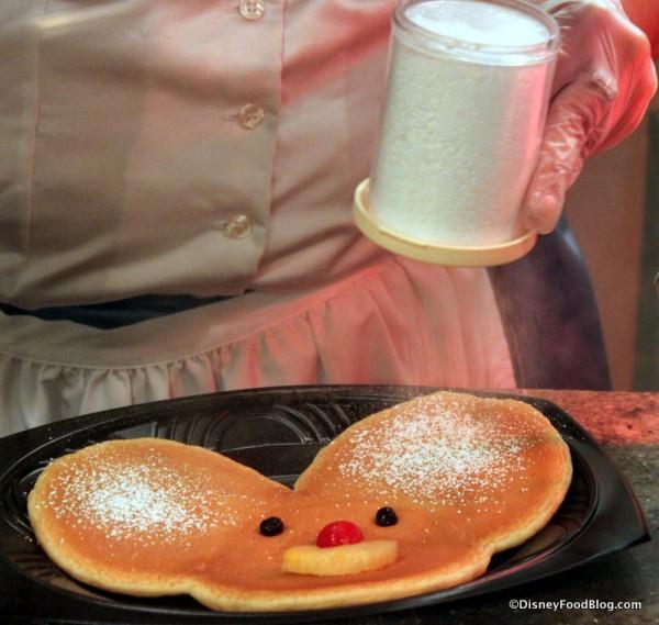 Dusting My Mickey Pancake with Powdered Sugar