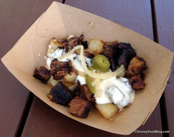 Beef Brisket Burnt Ends Hash with White Cheddar Fondue and Pickled Jalapeños from the Smokehouse Outdoor Kitchen