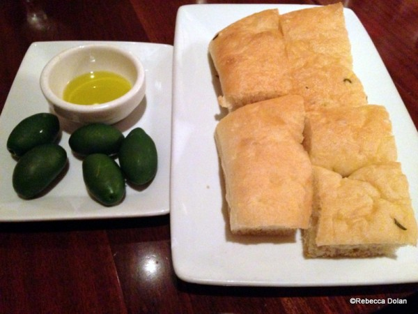 Focaccia and olives to eat while you look over the menu