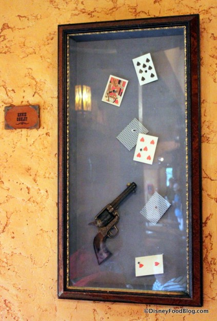 Revolver and Bullet-Riddled Playing Cards