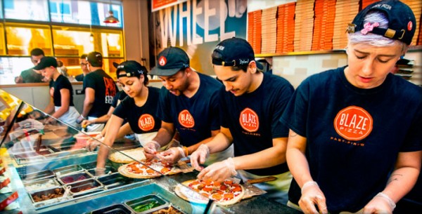 Blaze pizza's assembly line -- photo copyright Blaze pizza
