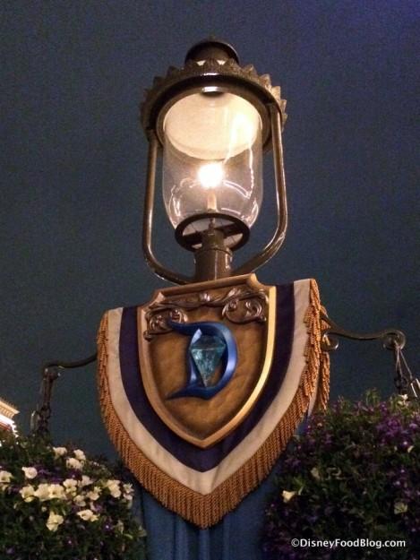 Disneyland Diamond Celebration logo on street lamp