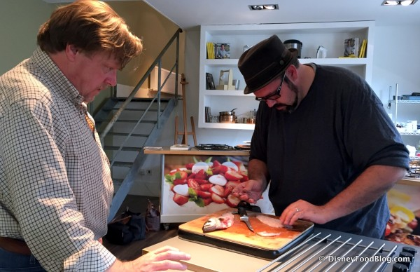 Aaron Getting Tips from John Cook on Filleting Fish