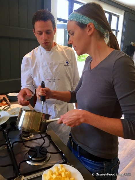 Colleen Receives Some Helpful Hints from Chef Julian