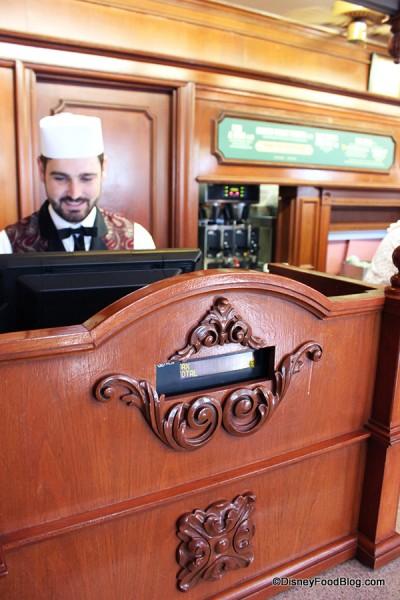 Crew member at the cash register.