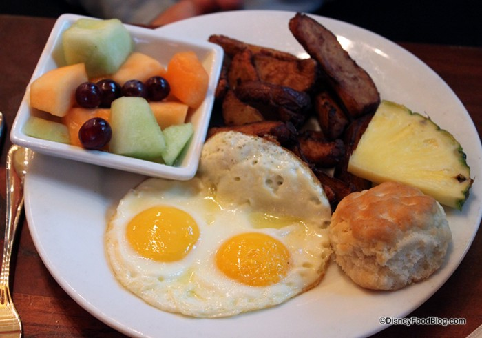 Two fried eggs and sides