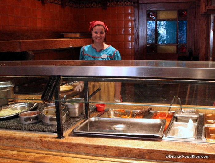 Disneyland Rancho del Zocalo_15_-Smiling cast member -- shows cafeteria like set up