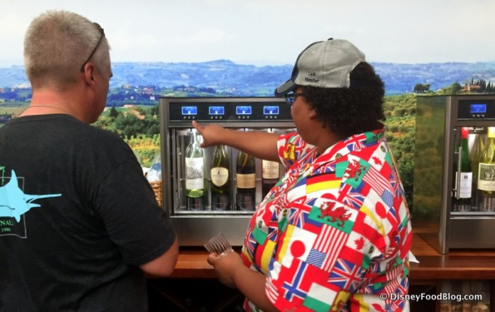Cast Member Assisting a Guest with the Wine Tasting Machines