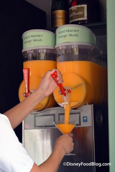 Cast Member Pouring a Grand Marnier Orange Slush