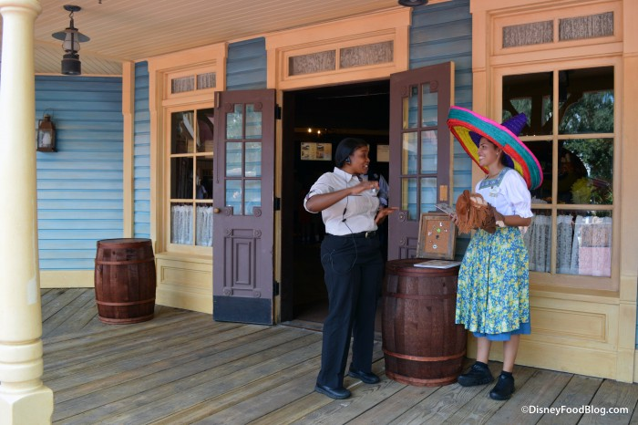 Cast Members Welcoming Guest at Pecos Bill Tall Tale Inn and Cafe