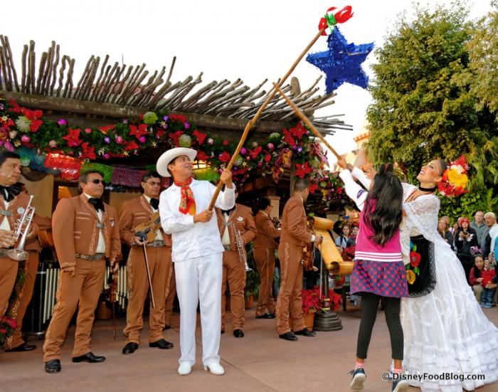 Breaking the Piñata During Las Navidad!