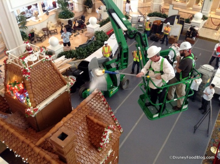 "Putting the ""snow"" on the gingerbread house at Grand Floridian"